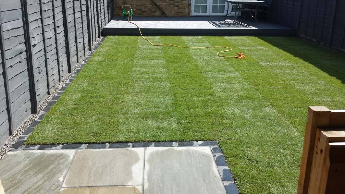 Sandstone paving and new lawn
